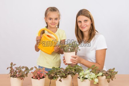 mom and daughter take care of