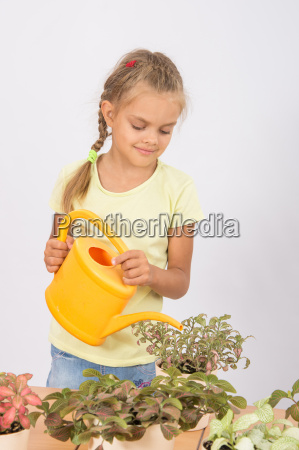 girl caring for household flowers fitton