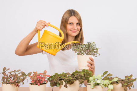 girl watering flowers decorative home