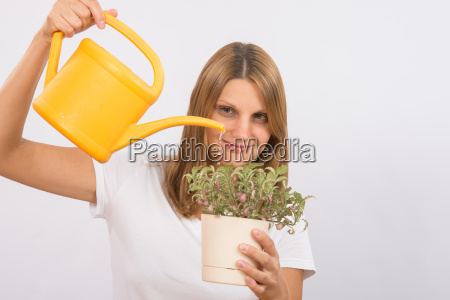 she pours a decorative flower in