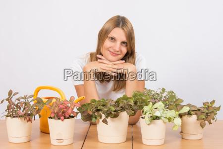 happy girl home indoor plants