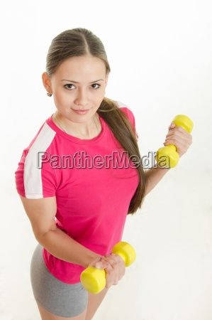 girl athlete with two dumbbells