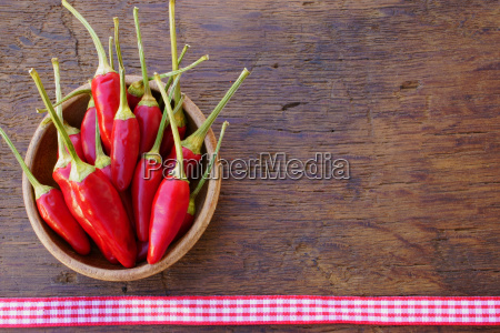 wooden bowl with fresh chili peppers
