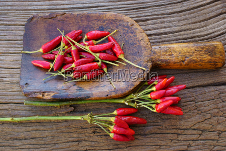 chili peppers on large antique spice