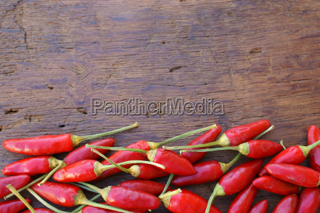 rustic wooden background with chilis