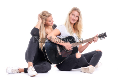 2 young girl sitting on the