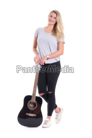 young blond girl stands in front