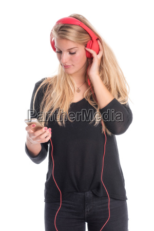 beautiful woman listens with headphones and