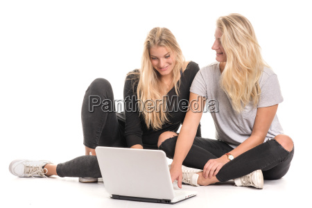 2 blonde girl sitting on the