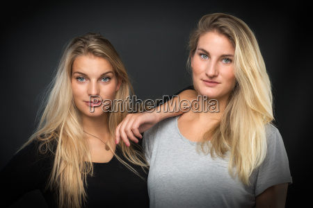 2 attractive blond young girl in