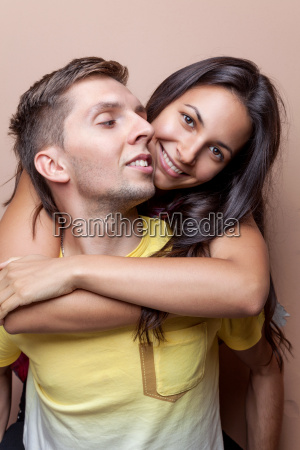 young happy couple in love embracing
