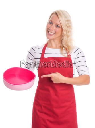 housewife in apron pointing at a