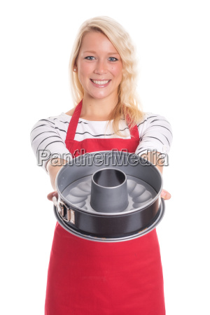 housewife in apron showing a baking