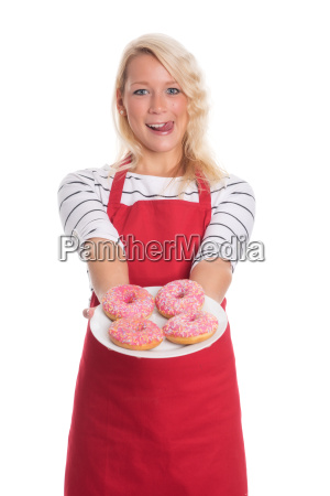blonde woman in apron holding a