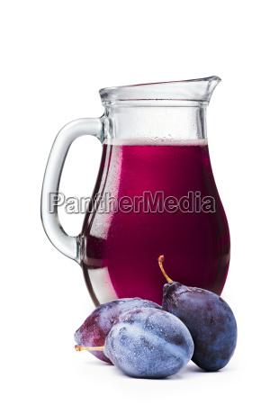 plum juice in a pitcher