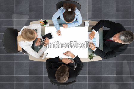 businesspeople working at desk