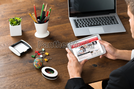 businessman reading news on mobile phone
