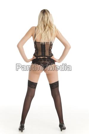 blond woman in underwear from behind