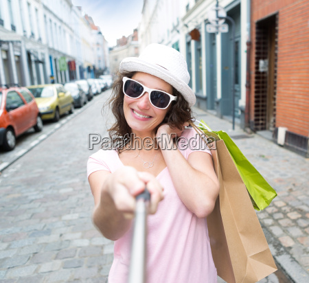 young attractive woman taking selfie while