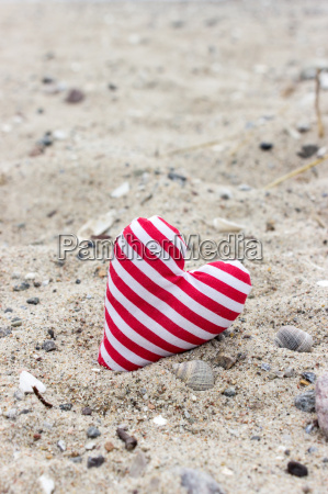 striped heart in the sand