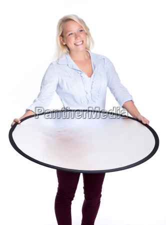 blond woman holding a photograph reflector