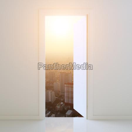 door open to city at sunset