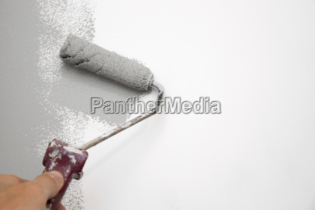 gray color painting wall with roller