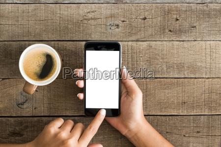 hand using phone white screen on