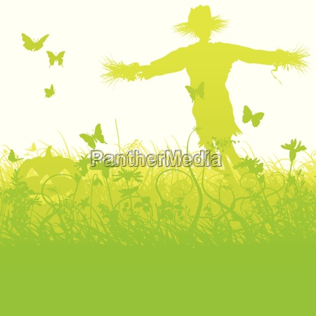 blades of grass and scarecrow with