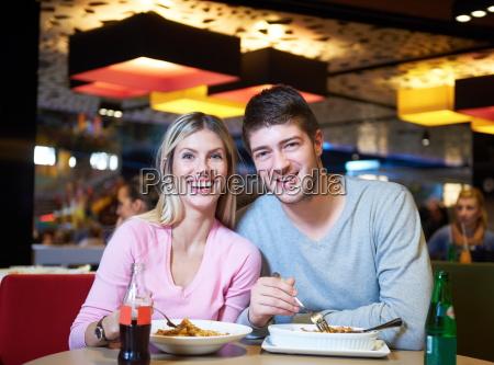 couple having lunch break in shopping
