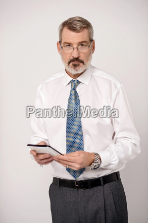 businessperson using touch pad device