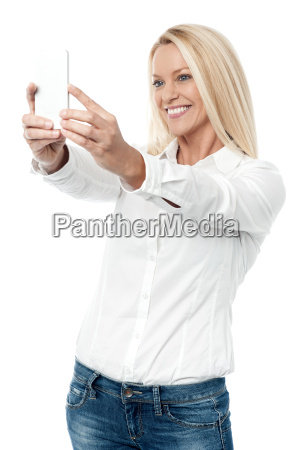 trendy woman clicking a selfie