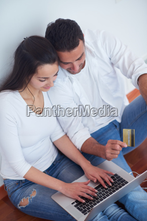 relaxed young couple working on laptop