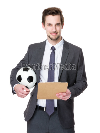 football manager hold with soccer ball