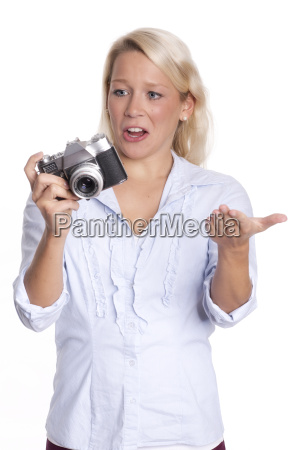 young woman with analog camera looks
