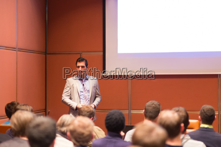 speaker giving a talk at business