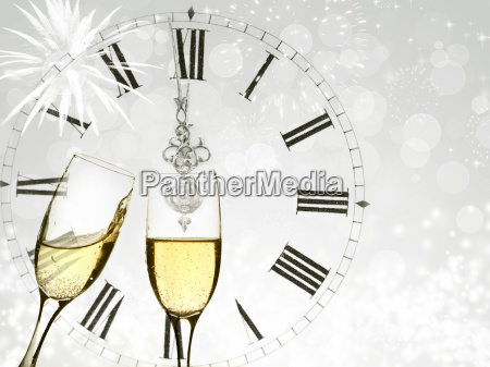 champagne over fireworks and clock close
