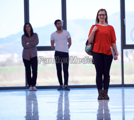 student girl standing with laptop people