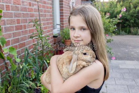 girl with a small rabbit on