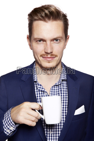 handsome man with coffee looking at