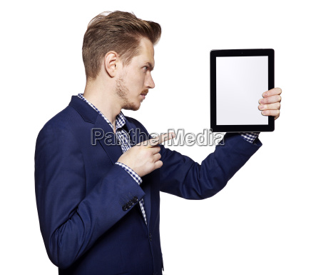 young man pointing at tablet pc