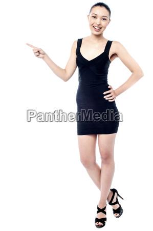 sexy young woman posing stylishly