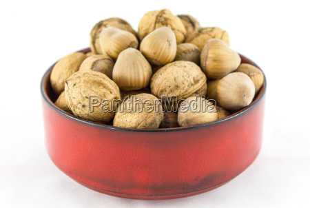 hazelnuts and walnuts in a red