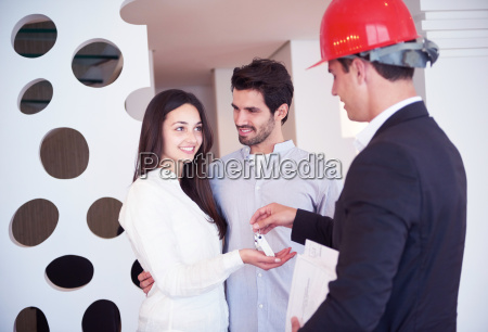 couple buying new home with real