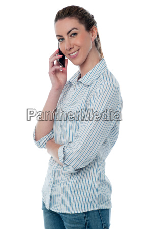 smiling woman attending phone call