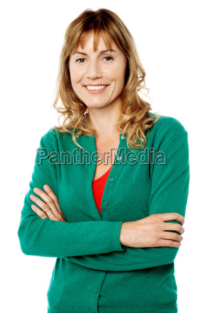 smiling woman posing with arms crossed