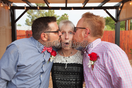 woman kissed by two men