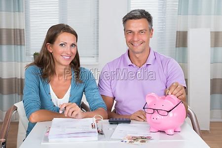 portrait of a couple calculating bills