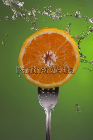 orange fruit half fork green health