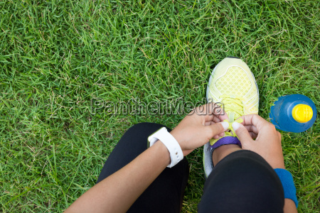 athletic woman tying laces ready to